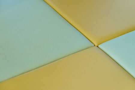 children play area: A close up of green and yellow soft mats in a kids play area.
