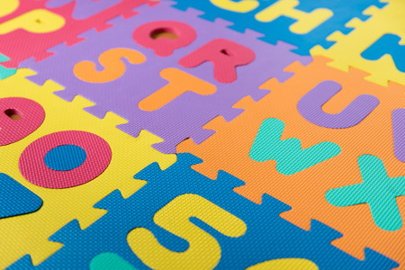 A section of a colorful foam ABC puzzlefloor mat. Stock Photo