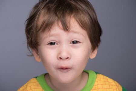 3 year old boy: A happy 3 year old JapaneseCaucasian boy making a funny face.