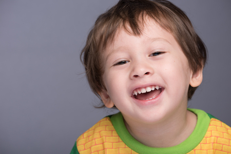 3 year old: A happy 3 year old JapaneseCaucasian boy smiling. Stock Photo