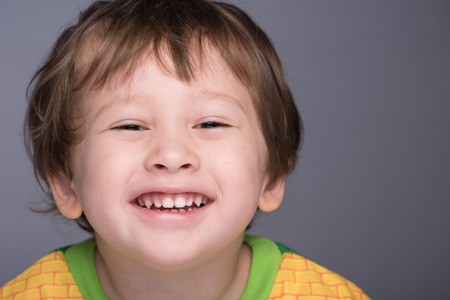 3 year old boy: A happy 3 year old JapaneseCaucasian boy smiling. Stock Photo