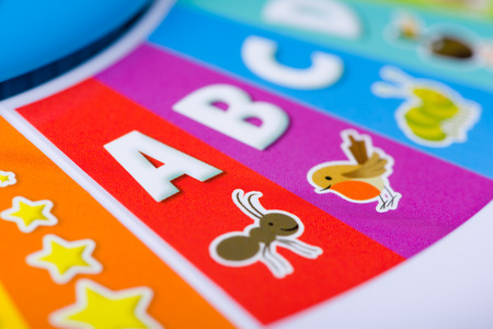 abc's: A close up shot of a colorful kids toy with the ABCs, animals and stars on it.