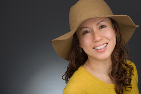approachable: A headshot of a smiling middle aged Japanese woman. Stock Photo