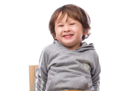 3 year old: A cute 3 year old boy with a happy expression on a white background.