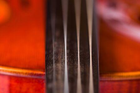 violins: A close up shot of the details of a violin.