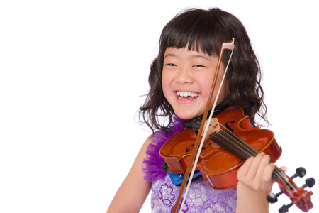 A portrait of a cute, happy and young Japanese girl in a purple dress on a white background with a violin.