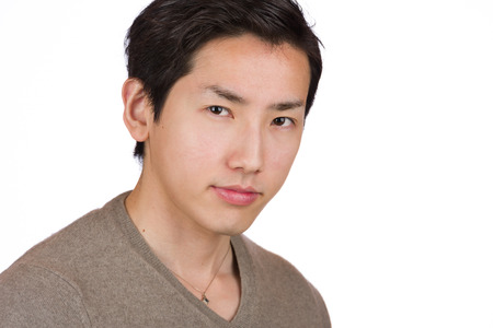 headshot: A headshot of a young handsome Japanese man. Stock Photo