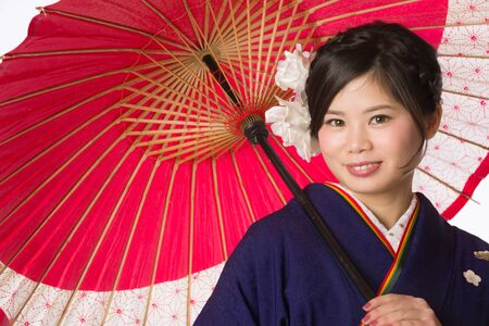 20 year old girl: A portrait of a beautiful young Japanese girl in a blue kimono for her coming of age ceremony on her 20th birthday.