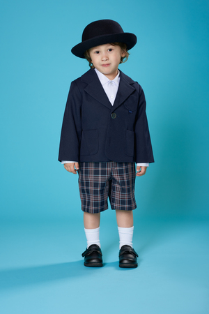 A 3 year old half Japanese, half American boy dressed in a preschool uniform.