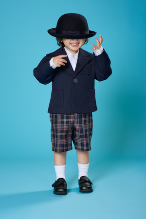 3 year old boy: A 3 year old half Japanese, half American boy dressed in a preschool uniform.