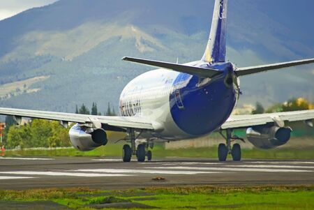 strips away: airplane take off close-up rear view Stock Photo