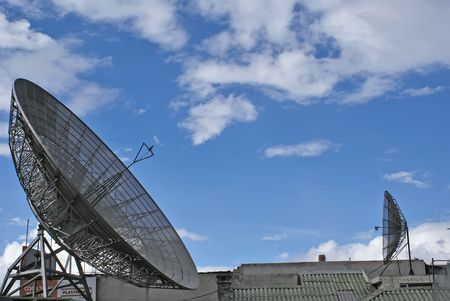 intercommunication: 2 two dishes aerials over blue sky Stock Photo