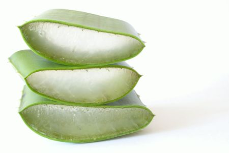prickle: stack of sliced aloe isolated on white background