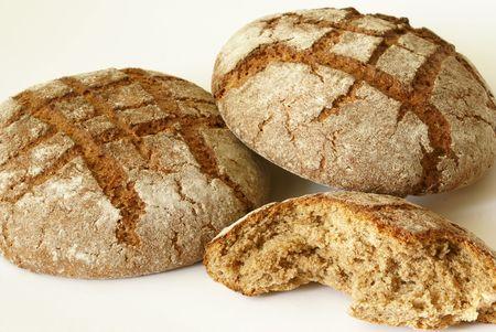 Fresh tasty dark bread isolated on the white background. Stock Photo - 746322