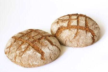 unsliced: Fresh tasty dark bread isolated on the white background. Stock Photo