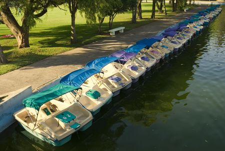 grassplot: Row of the catamarans in the pond of the city park