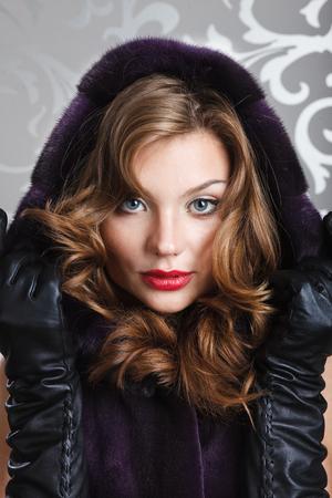 mink: beautiful girl portret in brown mink fur coat Stock Photo