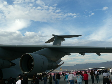 Military air show - Lockheed C-5 Galaxy transport plane and colorful sky