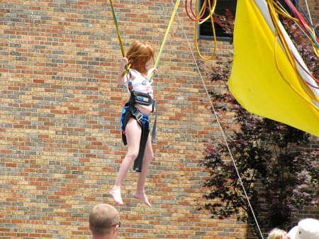 Johnson City, Tennessee - United States - 06-02-2012 - Blue Plum Festival - Girl on amusement ride