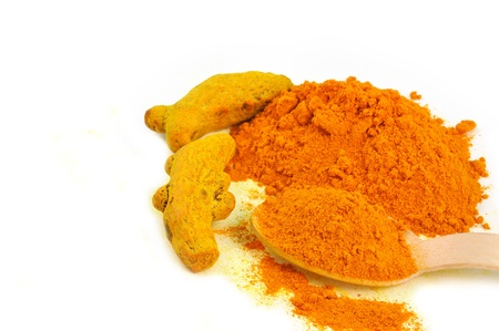 dye powder: close up of whole turmeric and powder Stock Photo