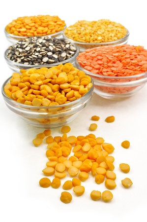 close up of variety of husked pulses in glass pots Standard-Bild