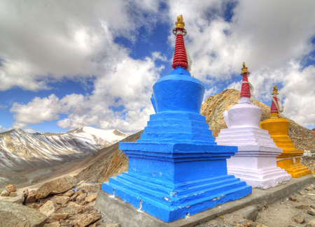 three buddhist stupa at the top of hill