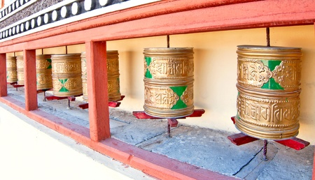 close up of buddhist prayer wheel in a monastery