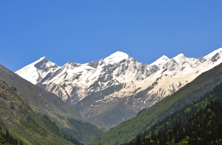 a group of four snow clad mountain peak Stock Photo