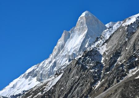 shivling: close shot of snow clad mountain peak Stock Photo