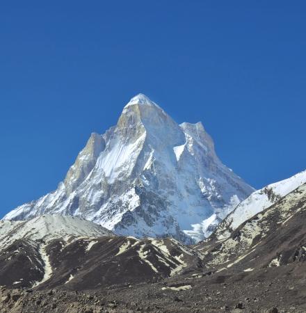 shivling: snow clad mountain peak Stock Photo