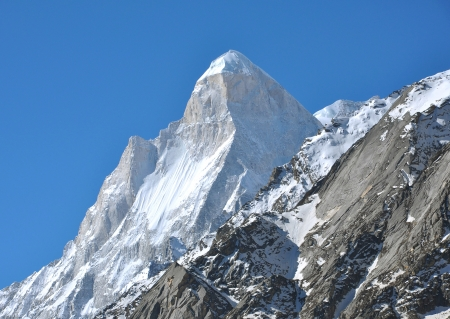 shivling: close shot of snow clad shivling peak