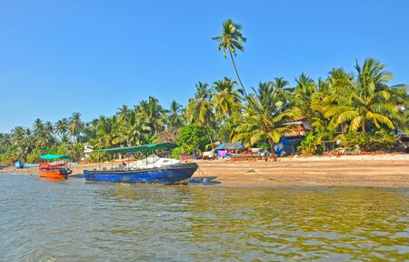 wide shot of sea coast  of goa with motor boats  photo