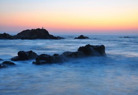 sea water waves hitting a part rocky coast