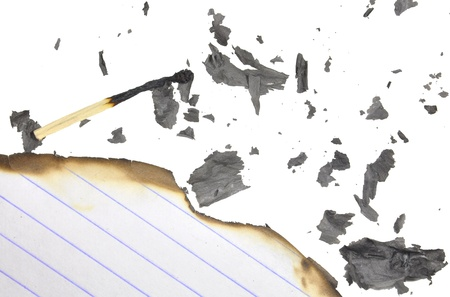 close up top view of partially burnt plain paper photo