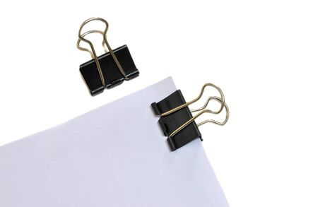 black paper clip with holded paper