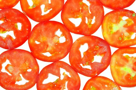 slices of tomato fruit arranged on white  photo