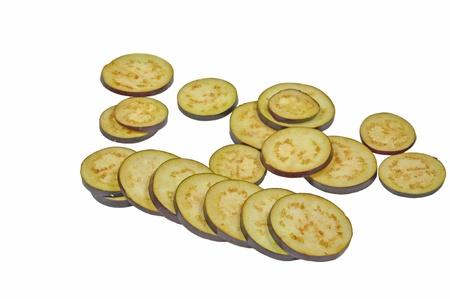 close up of slices of egg plant fruit arranged on white Stock Photo - 16825211