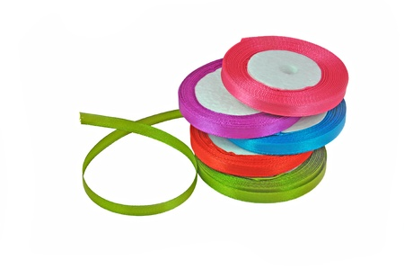 close up of rolls of colorful laces arranged on white  Standard-Bild