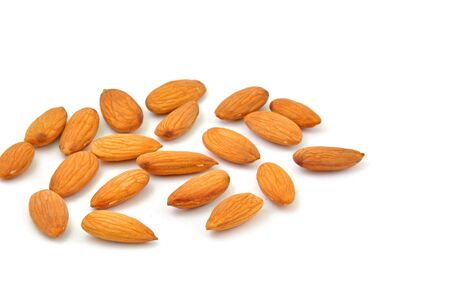 close up of shelled almonds scattered on white  Stock Photo