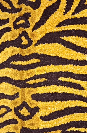 close up of carpet with resemblance of texture with tiger skin  photo