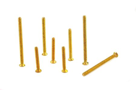 brass rod: close up of brass screws arranged on white background Stock Photo