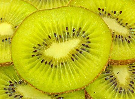 actinidia deliciosa: close up of slice of kiwi fruit