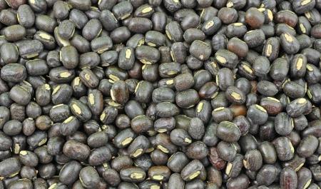 urad dal: close up pile of whole black gram seeds