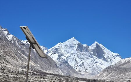 pannel: solar power pannel with backdrop of snow clad mountains
