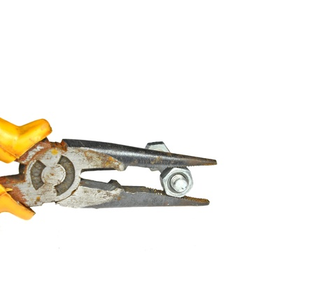 close up of plier with holded bolt and nut photo
