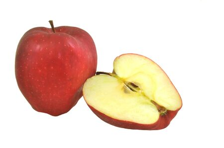whole and half cut apple arranged on white background Stock Photo