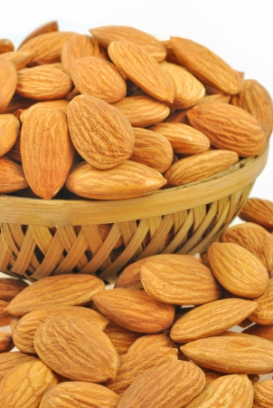 kept: almonds kept in basket Stock Photo