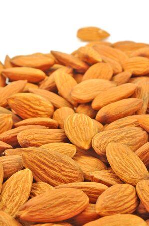 almonds piled on white  Stock Photo