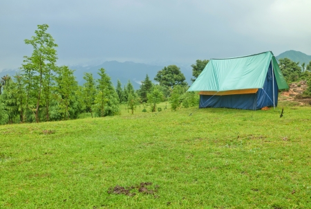 adventure tent in mountain meadow
