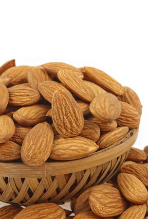close up of almonds kept in basket Stock Photo